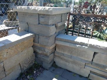 Black Canadian stone wall/pillar